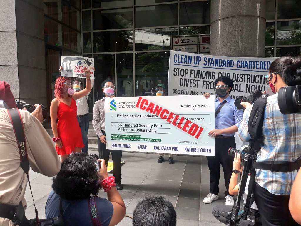 Climate activists in the Philippines were able to deliver their demand letter when they protested at the Standard Chartered office in Makati City. The amount on the check represents how much money the bank has poured into coal in the country. Image credit: Youth Advocates for Climate Action Philippines