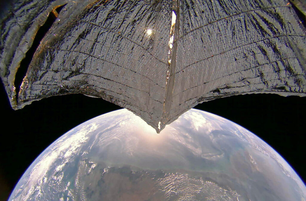 LightSail is a crowdfunded project of The Planetary Society. This image taken by LightSail 2 on Jan. 21, 2020 includes the west coast of India. North is at right. The sail appears slightly curved due to the spacecraft's 185-degree fisheye camera lens. The image has been color corrected and some of the distortion has been removed. Image credit: The Planetary Society