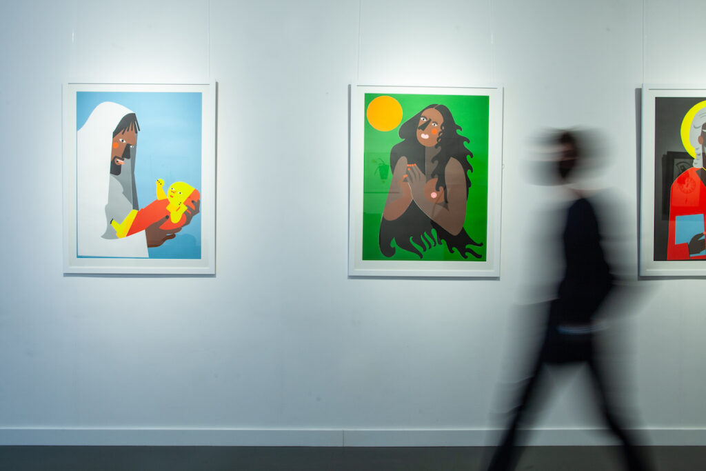 An art investor walks past 'Temporary Friend', a unique set of five relief prints by Nina Chanel Abney. Image credit: HOFA Gallery