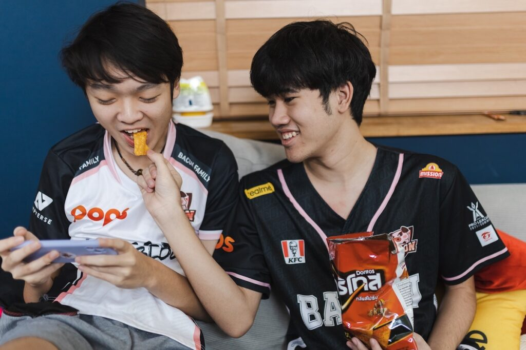 Thai professional esports team Bacon Time, which emerged victorious in the finals of Arena of Valor's Realm of Valor Pro League 2021 Summer tournament, has partnered with PepsiCo's Doritos to create brand awareness among the millennial generation in Thailand. Image credit: Ampverse
