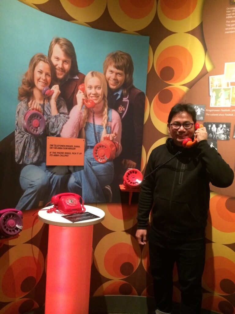"""The writer at ABBA The Museum in Stockholm during his visit to Sweden in 2016. The phone that he is holding was used by his favorite ABBA member, Agnetha Fältskog, in the promotion photos for """"Ring Ring"""" in 1972."""